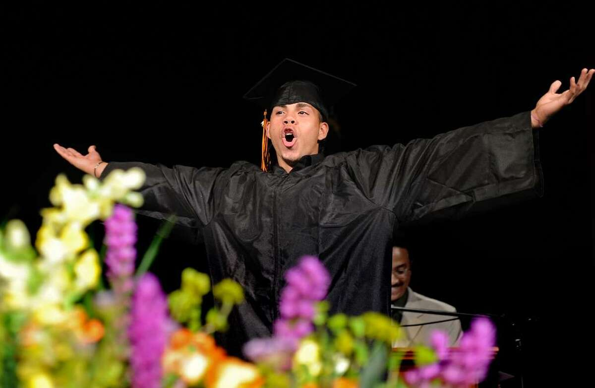 Sam Ortiz shouts to friends and family in the audience as he walks across the stage to accept his diploma during the 2010 Bullard-Havens Technical High School graduation ceremony Thursday June 10 at Klein Memorial Auditorium in Bridgeport.