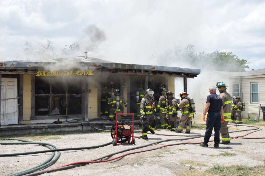 Firefighters on Thursday, July 13, 2017, responded to a blaze at a West Side furniture upholstery business. Photo: Caleb Downs / San Antonio Express-News