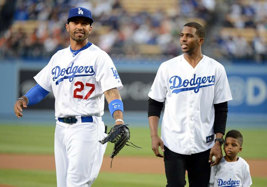 LOS ANGELES, CA - APRIL 02:  Chris Paul #3 of the Los Angeles Clippers and his son Chris Paul Jr. participate in a ceremonial first pitch with Matt Kemp #27 of the Los Angeles Dodgers before the game against the San Francisco Giants at Dodger Stadium on April 2, 2013 in Los Angeles, California.  (Photo by Harry How/Getty Images) Photo: Harry How/Getty Images