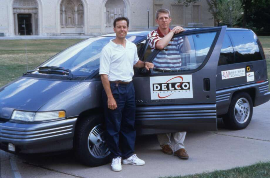 Dean Pomerleau and Todd Jochem posed with NavLab 5 20 years ago before setting off on a trip to California. The minivan did almost all of the steering on the tour, which was called No Hands Across America. Photo: Carnegie Mellon University