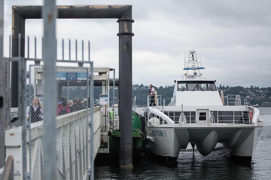 Commuters board Kitsap Transit's new fast ferry, the Rich Passage 1, on Wednesday, July 13, 2017. Photo: GRANT HINDSLEY, SEATTLEPI.COM / SEATTLEPI.COM