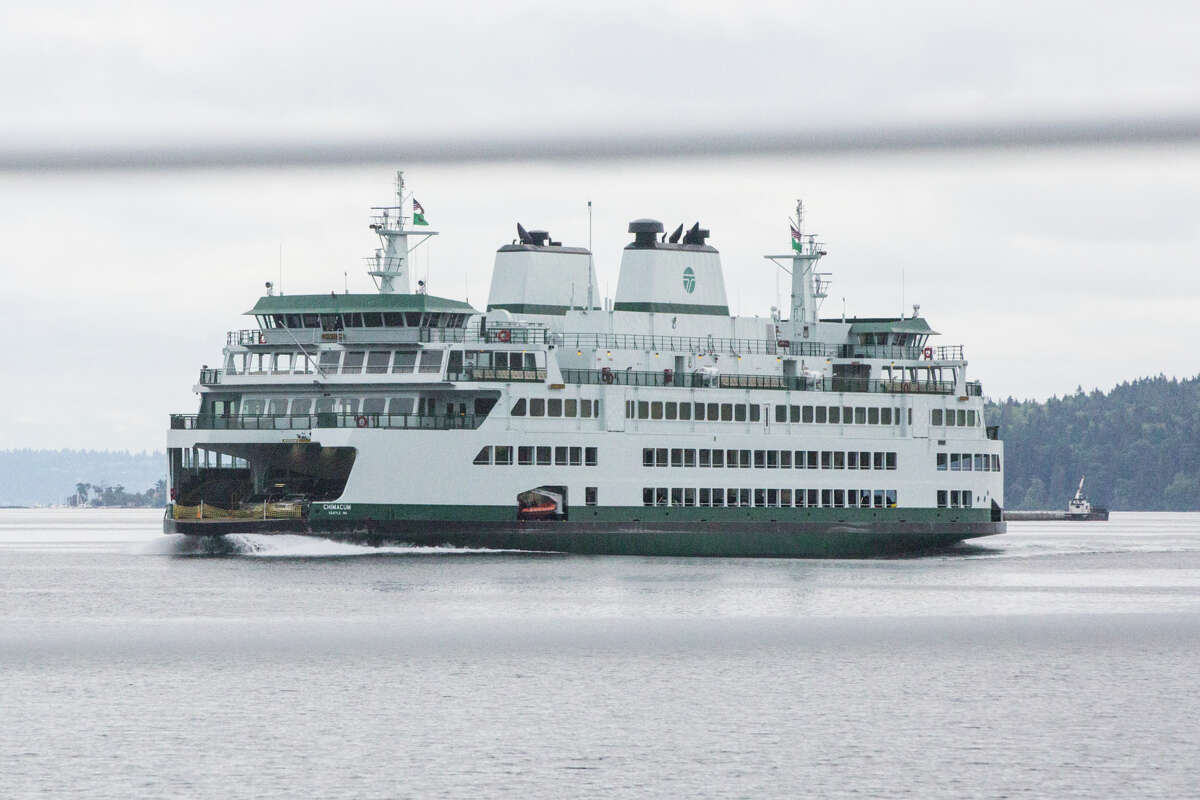 The Chimacum passes by Kitsap Transit's new fast ferry on Rich Passage on the way into Seattle on Wednesday, July 13, 2017.