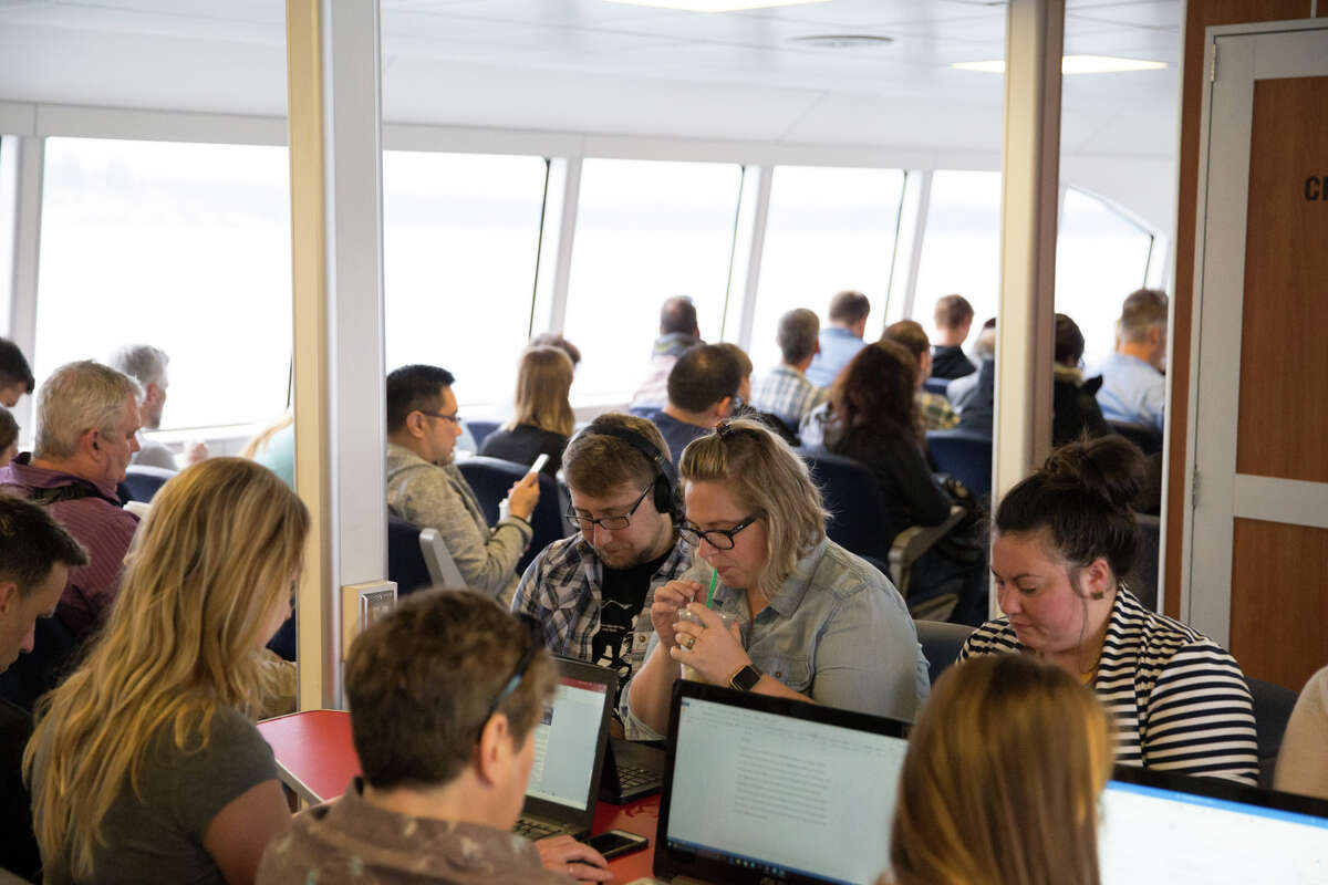 Commuters work on their laptops during the 35-ish minute ride to Seattle via Kitsap Transit's new fast ferry on Wednesday, July 13, 2017.