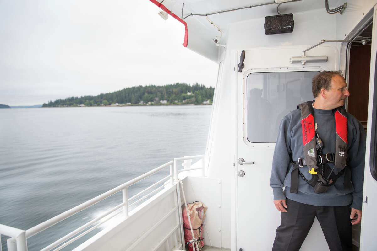 A Kitsap Transit ferry worker rides their new fast ferry on Wednesday, July 13, 2017.