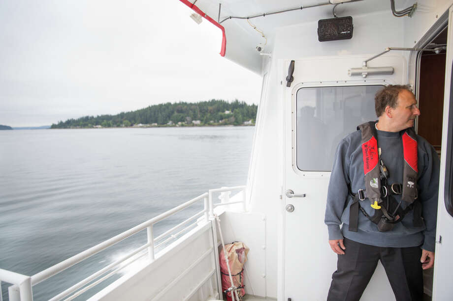 A Kitsap Transit ferry worker rides their new fast ferry on Wednesday, July 13, 2017. Photo: GRANT HINDSLEY, SEATTLEPI.COM / SEATTLEPI.COM