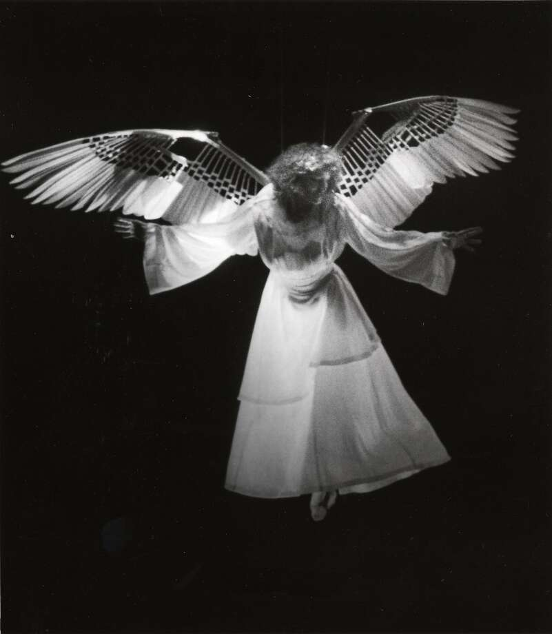 """The Angel (Ellen McLaughlin) arrives in the world premiere of """"Angels in America,"""" Eureka Theatre Company, San Francisco, 1991. These original wings, designed by Sandra Woodall, will be on display in the exhibition.     Credit:  Katy Raddatz/Museum of Performance & Design Photo: Katy Raddatz, Museum Of Performance & Design"""