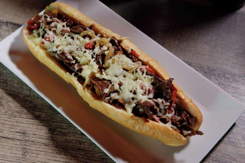 A view of a Philly cheese steak with roasted red peppers, onions and mozzarella cheese at the Philly Bar and Lounge on Monday, June 26, 2017, in Latham, N.Y. (Paul Buckowski / Times Union)