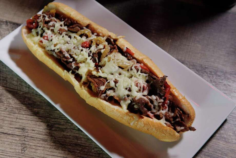 A view of a Philly cheese steak with roasted red peppers, onions and mozzarella cheese at the Philly Bar and Lounge on Monday, June 26, 2017, in Latham, N.Y.  (Paul Buckowski / Times Union) Photo: PAUL BUCKOWSKI / 40040872A