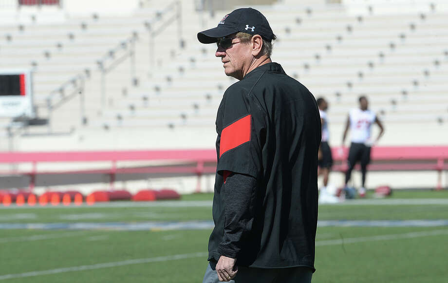 Lamar's new head coach Mike Schultz observes the players as they run drills on the opening day of  spring practice Tuesday at Provost Umphrey Stadium Tuesday.  Photo taken Tuesday, March 21, 2017 Kim Brent/The Enterprise Photo: Kim Brent / BEN