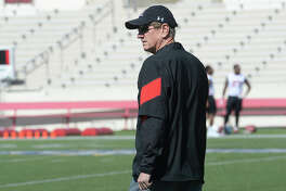 Lamar's new head coach Mike Schultz observes the players as they run drills on the opening day of  spring practice Tuesday at Provost Umphrey Stadium Tuesday.  Photo taken Tuesday, March 21, 2017 Kim Brent/The Enterprise