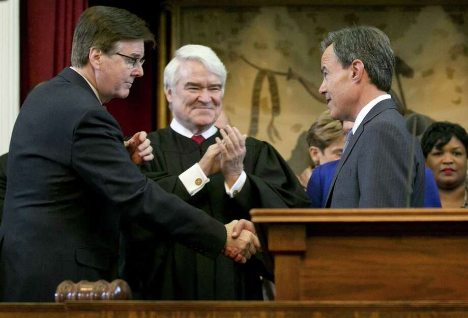 Speaker of the House Joe Straus, right, is congratulated by Lt. Gov.-elect Dan Patrick, left, and Texas Supreme Court Chief Justice Nathan Hecht, middle, before being sworn in as Speaker on the first day of the 84th legislative session at the Capitol in Austin, Tx., on Tuesday January 13, 2015.  (AP PHOTO/Jay Janner Austin American-Statesman) Photo: Jay Janner / Jay Janner / Austin American-Statesman