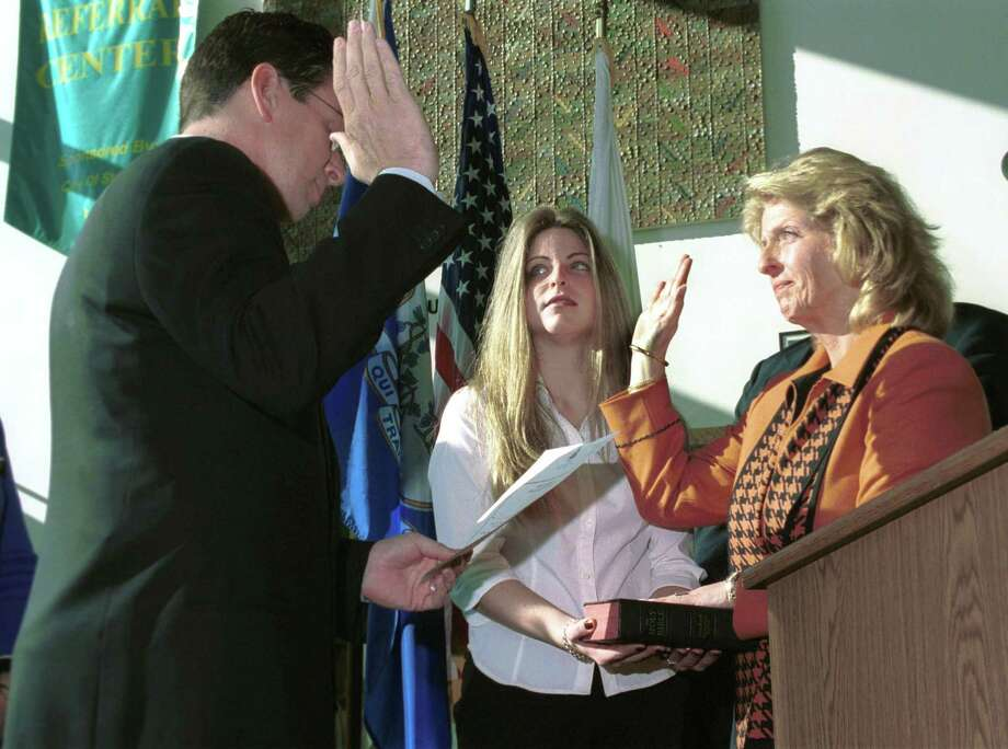 FILE — In this photo from 2001, former Mayor Dannel Malloy swears in Donna Loglisci (R) as Town Clerk. Photo: Hearst Connecticut Media File Photo