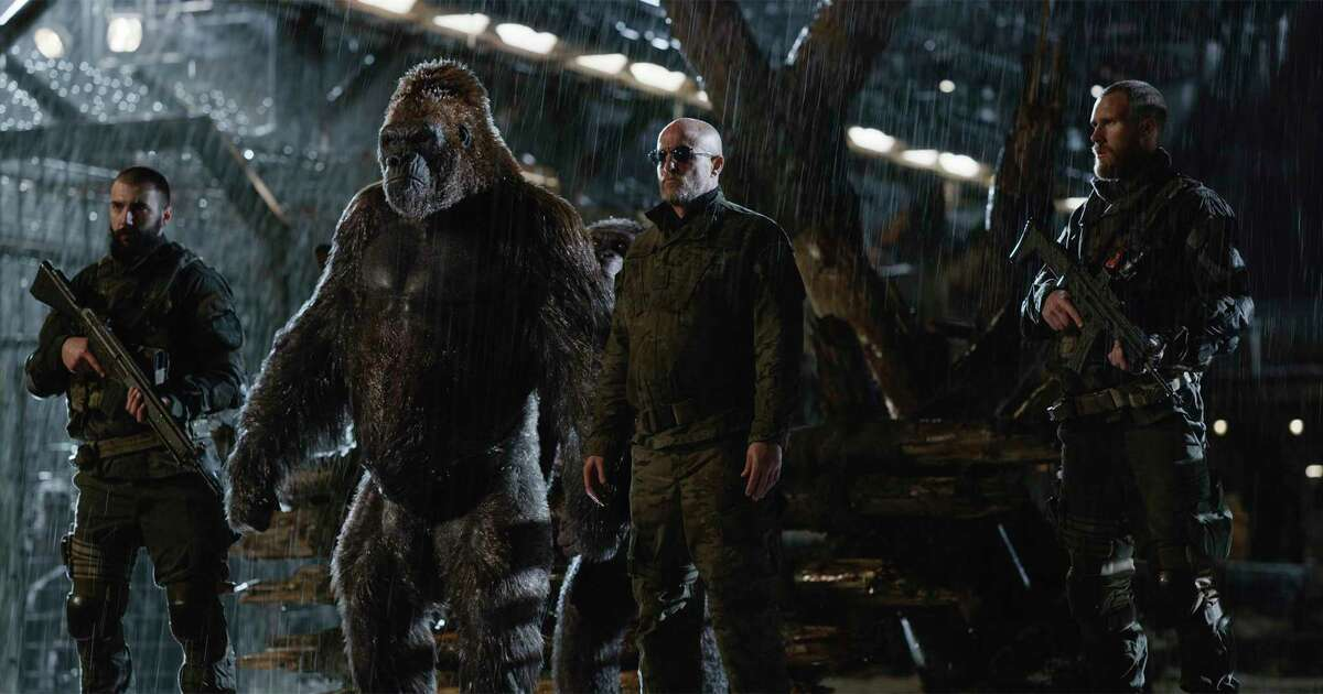 """Woody Harrelson, right, is a menacing delight as the ape-exterminating Colonel in """"War for the Planet of the Apes."""""""