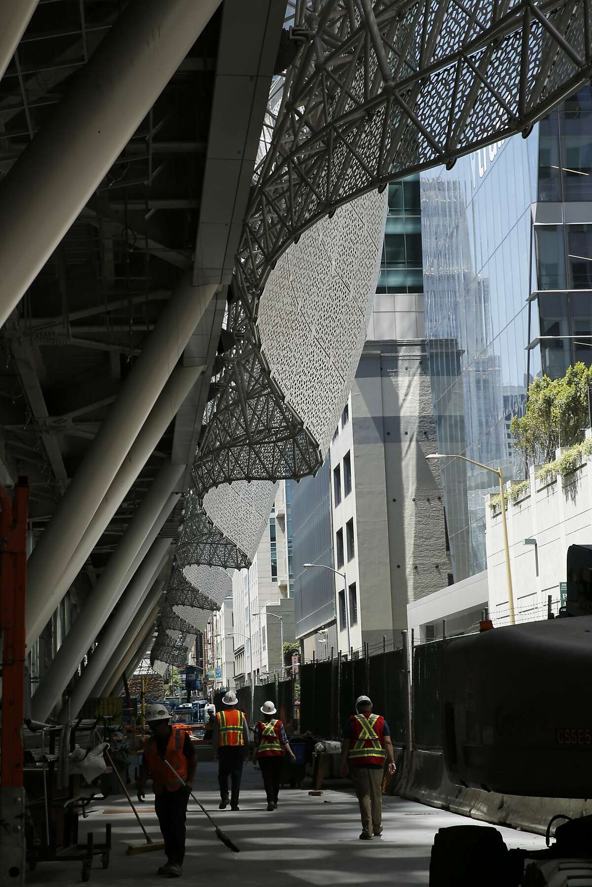 Workers continue construction at the Transbay Transit Center on Thursday, June 22, 2017, in San Francisco, Calif.
