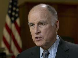 "FILE - In this May 31, 2017 file photo, California Gov. Jerry Brown speaks during an interview in Sacramento, Calif. Brown announced yet another plan Wednesday, July 12, 2017, to keep the United States on track to reduce greenhouse gas emissions under the international Paris climate agreement. This time, he's teaming up with former New York City Mayor Michael Bloomberg to launch ""America's Pledge,"" an initiative to compile all of the climate change-fighting commitments of states, cities, businesses and universities in one place where they can be easily tracked and shared.  (AP Photo/Rich Pedroncelli, File)"