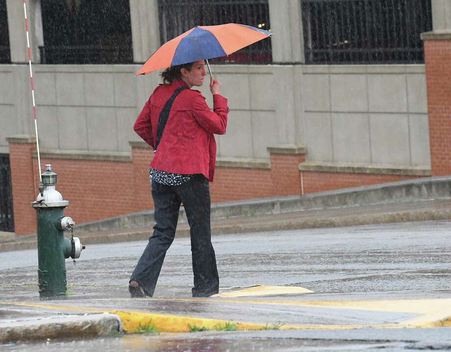 A woman looks before crossing the street along Madison Ave. on a rainy afternoon Wednesday, July 12, 2017 in Albany, N.Y. (Lori Van Buren / Times Union) Photo: Lori Van Buren, Albany Times Union