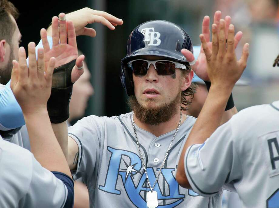 Tampa Bay Rays' Colby Rasmus celebrates after scoring against the Detroit Tigers during the fifth inning of a baseball game Saturday, June 17, 2017, in Detroit. (AP Photo/Duane Burleson) Photo: Duane Burleson, Associated Press / FR38952 AP