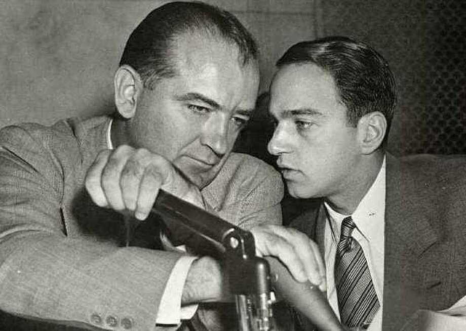 "The new documentary, ""The Lavender Scare,"" shows how the anti-Communist witch hunt of Sen. Joseph McCarthy, left, would later extend to homosexuals working for the government. Ironically, his assistant, Roy Cohn, was a closeted gay man. Photo: Contributed Photo / Connecticut Post Contributed"