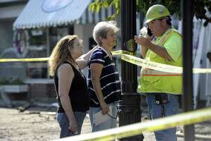 Judy Staib, center, owner of 178 Greenwood Ave. in Bethel, the scene of an early  morning fire, Thursday, July 13, 2017, that left several families homeless and some businesses closed in the heart of downtown.
