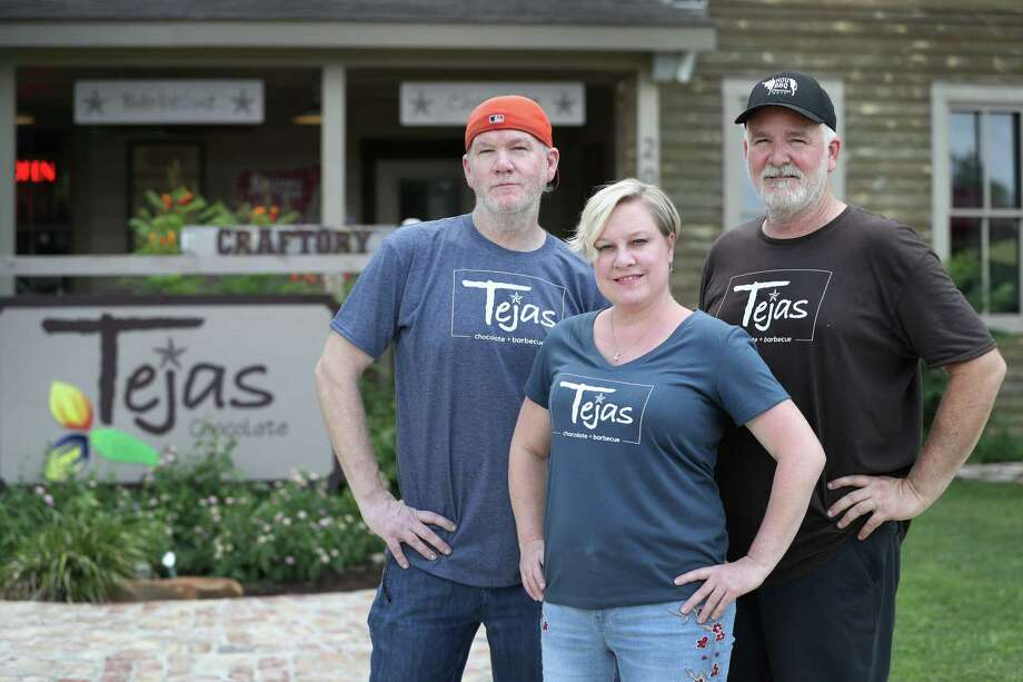 Chef Greg Moore (left-right), Michelle Holland and owner Scott Moore pose in front of Tejas Chocolate Craftory, a joint that's an unlikely merge of chocolate shop and barbecue restaurant Wednesday, June 14, 2017, in Tomball. Since it was ranked the 6th best BBQ joint in the state on Texas Monthly's list recently, it's been really busy.  ( Steve Gonzales  / Houston Chronicle ) Photo: Steve Gonzales, Staff / © 2017 Houston Chronicle