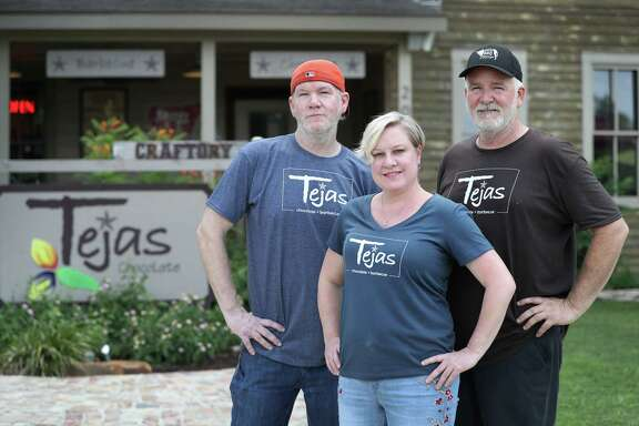 Chef Greg Moore (left-right), Michelle Holland and owner Scott Moore pose in front of Tejas Chocolate Craftory, a joint that's an unlikely merge of chocolate shop and barbecue restaurant Wednesday, June 14, 2017, in Tomball. Since it was ranked the 6th best BBQ joint in the state on Texas Monthly's list recently, it's been really busy.  ( Steve Gonzales  / Houston Chronicle )