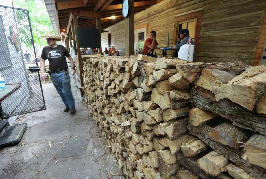 A stack for wood for the smoker outside Tejas Chocolate Craftory in Tomball. Photo: Steve Gonzales, Staff / © 2017 Houston Chronicle