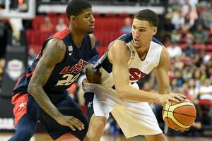 LAS VEGAS, NV - AUGUST 01:  Klay Thompson #21 of the 2014 USA Basketball Men's National Team looks to pass against Paul George #29 of the 2014 USA Basketball Men's National Team during a USA Basketball showcase at the Thomas & Mack Center on August 1, 2014 in Las Vegas, Nevada.  (Photo by Ethan Miller/Getty Images)