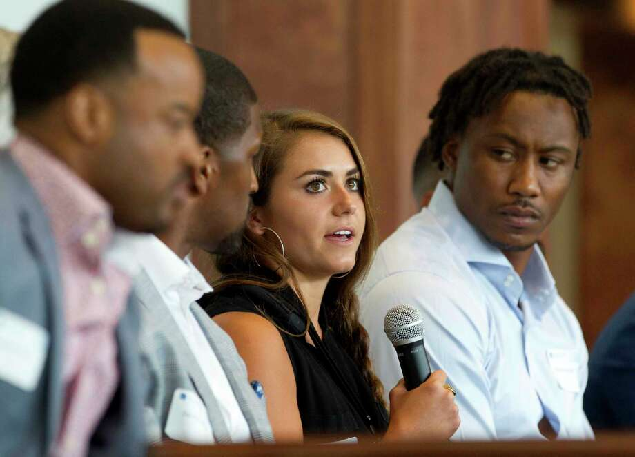 "Kassidy Cook, Olympic diver and 2013 graduate of The Woodlands High School, speaks as Brandon Marshall, NFL wide receiver with the New York Giants, looks on during a sports forum titled ""Going Pro"" at The Woodlands Country Club, Wednesday, July 12, 2017, in The Woodlands. The 10-person panel comprised of athletes, health care providers and others from the sports industry offered advice and answered questions about college recruitment and competing at the professional level. Photo: Jason Fochtman, Staff Photographer / © 2017 Houston Chronicle"