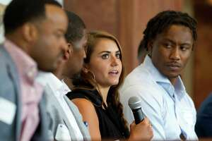 """Kassidy Cook, Olympic diver and 2013 graduate of The Woodlands High School, speaks as Brandon Marshall, NFL wide receiver with the New York Giants, looks on during a sports forum titled """"Going Pro"""" at The Woodlands Country Club, Wednesday, July 12, 2017, in The Woodlands. The 10-person panel comprised of athletes, health care providers and others from the sports industry offered advice and answered questions about college recruitment and competing at the professional level."""