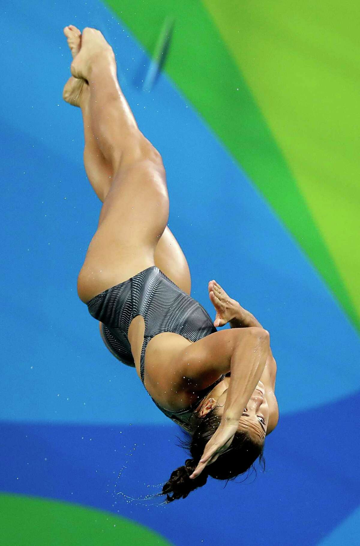 United States' Kassidy Cook competes during the women's 3-meter springboard diving preliminary round in the Maria Lenk Aquatic Center at the 2016 Summer Olympics in Rio de Janeiro, Brazil, Friday, Aug. 12, 2016. (AP Photo/Wong Maye-E)