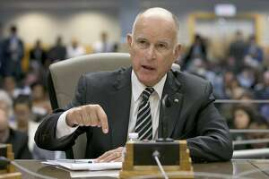 California Gov. Jerry Brown, left, responds to a question while testifying in support of Assembly Bill 398, by Assemblyman Eduardo Garcia, D-Coachella, one of two bills to extend state's cap and trade program, during a hearing of the Senate Environmental Quality committee, Thursday, July 13, 2017, in Sacramento, Calif. (AP Photo/Rich Pedroncelli)