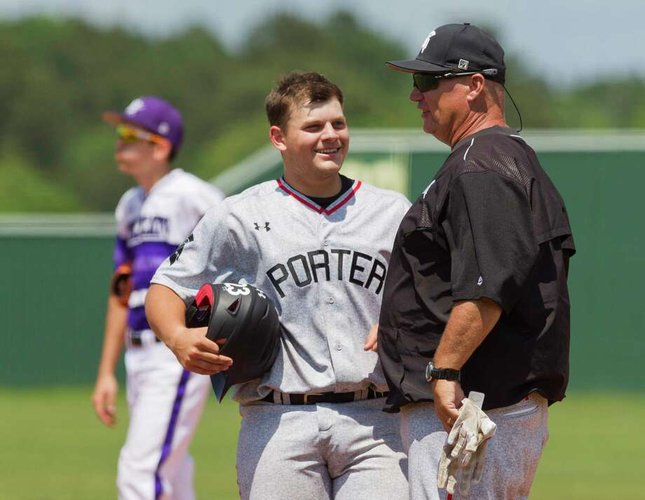 Wayne Ralph, shown here this past spring talking with Porter catcher Brent Sipe, was recently promoted to head coach of the Spartans after the departure of coach Justin Roland. Photo: Jason Fochtman, Staff Photographer / © 2017 Houston Chronicle