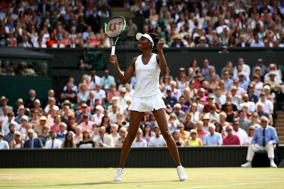 Venus Williams celebrates match point and victory during the Ladies Singles semi final match against Johanna Konta of Great Britain on day ten of the Wimbledon Lawn Tennis Championships. Photo: Julian Finney, Getty Images