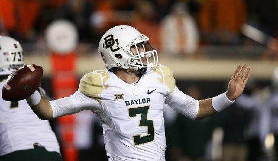 Baylor quarterback Jarrett Stidham throws a pass at Oklahoma State on Nov. 21, 2015. (AP Photo/Sue Ogrocki) Photo: Sue Ogrocki /AP Photo