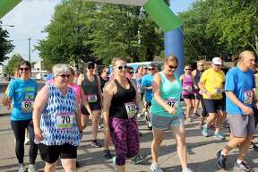 Dozens of runners and walkers participated in the TOCU Tri to Finish Wine Run/Walk 5K Thursday evening in Bad Axe City Park. Proceeds went to the Bad Axe Soccer Association.