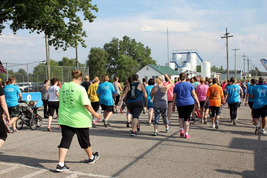 Dozens of runners and walkers participated in the TOCU Tri to Finish Wine Run/Walk 5K Thursday evening in Bad Axe City Park. Proceeds went to the Bad Axe Soccer Association. Photo: Brenda Battel