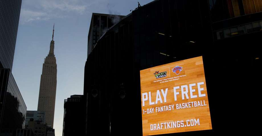FILE - In this Jan. 6, 2016 file photo, an electronic advertisement for DraftKings hangs on the side of Madison Square Garden in New York. On Thursday, July 13, 2017, DraftKings announced it pulled out of a proposed merger with FanDuel, scrapping potential partnership between fantasy sports companies. (AP Photo/Mark Lennihan, File) Photo: Mark Lennihan/Associated Press