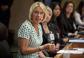 Betsy DeVos holds a news conference Thursday, after a day of meetings weighing whether to keep Obama-era guidance on a federal law that prohibits sex discrimination at federally funded institutions.