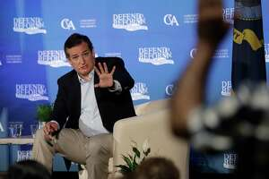 Sen. Ted Cruz debates with audience members over health care during a town hall meeting in Austin.