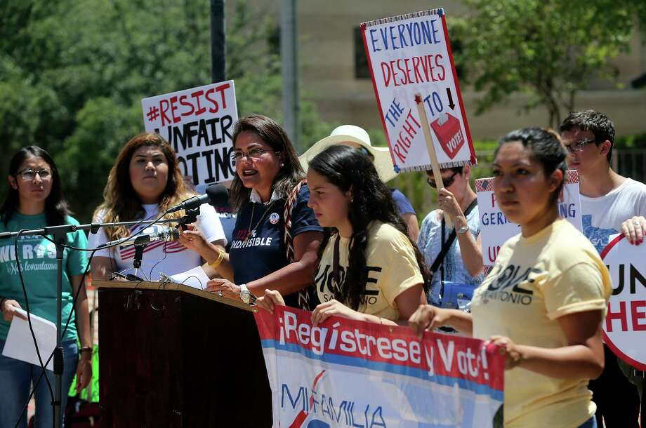 A crowd outside of the federal courthouse in 2017 protest suppression of the minority vote due to the redrawing of districts. Why not ask Texas voters if they are happy with how redistricting is done in Texas? Photo: Staff File Photo / ©John Davenport/San Antonio Express-News