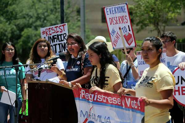 A crowd outside of the federal courthouse in 2017 protest suppression of the minority vote due to the redrawing of districts. Why not ask Texas voters if they are happy with how redistricting is done in Texas?