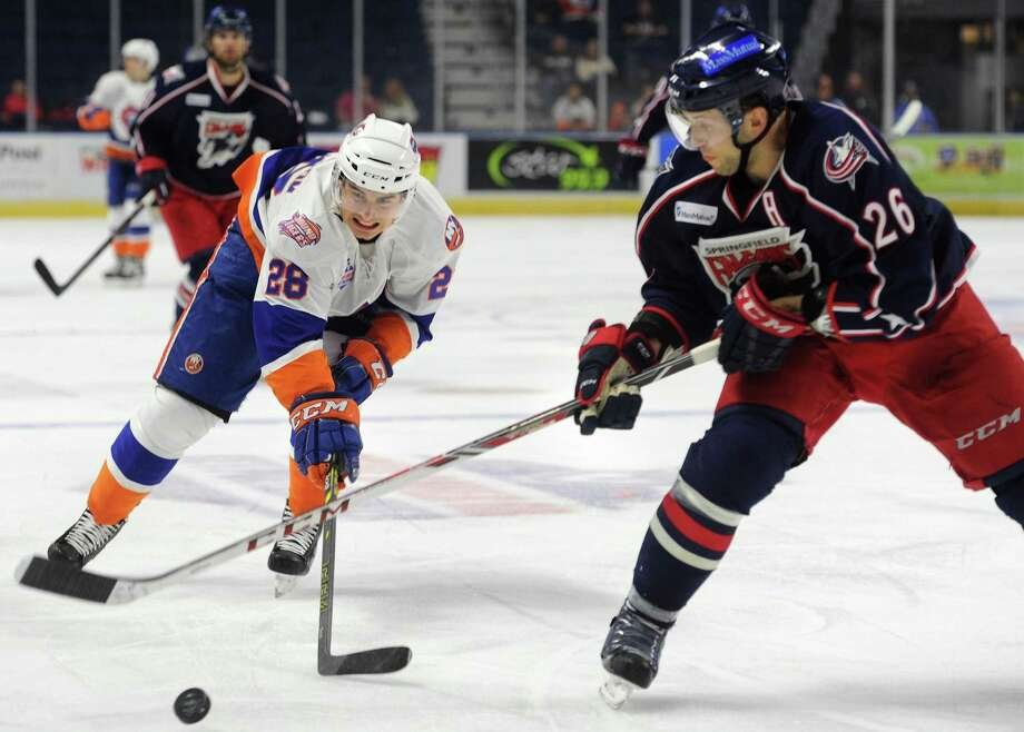 Sound Tiger Johan Sundstrom, left, works the puck in against Springfield defender Jaime Sifers, right, defends against Sound Tiger Johan Sundstrom on Nov. 16, 2014, at Webster Bank Arena in Bridgeport. Photo: Brian A. Pounds / Brian A. Pounds / Connecticut Post