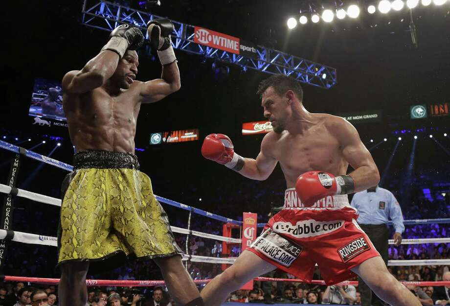 Floyd Mayweather Jr., left, dodges a punch by Robert Guerrero in the third round during a WBC welterweight title fight, Saturday, May 4, 2013, in Las Vegas. (AP Photo/Rick Bowmer) Photo: Rick Bowmer / AP / AP