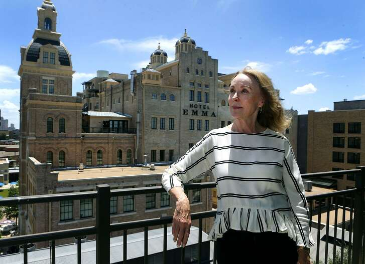 Betty Boston, shown standing on her apartment balcony, has lived at The Pearl for seven years and has witnessed many of its transformations.