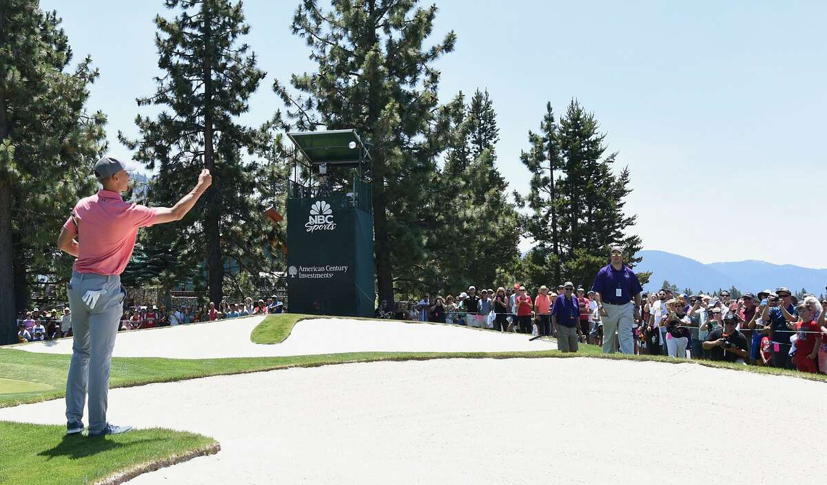 Stephen Curry tosses a ball to kids on 18th green during a practice round ahead of the American Century Championship at Edgewood Tahoe Golf Course on Thursday July 13, 2017 in Stateline, Nevada.