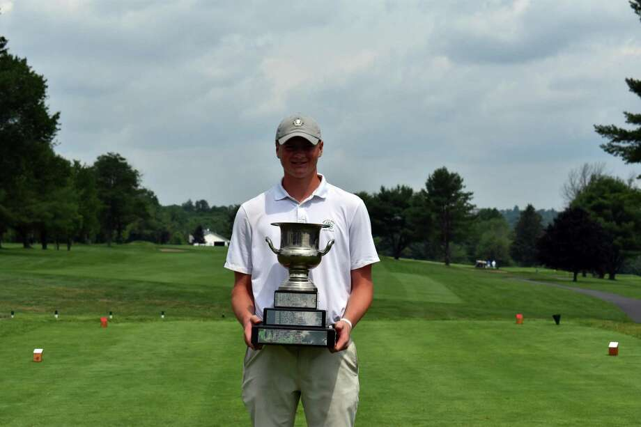 Darien's Will Wilson poses with his trophy after winning the 76th Connecticut Junior Amateur, on Thursday at Watertown Golf Club in Watertown. Wilson defeated defending champion Andrew Franz of Ridgefield 5-and-3. Photo: Connecticut State Golf Association / Contributed Photo / Stamford Advocate Contributed