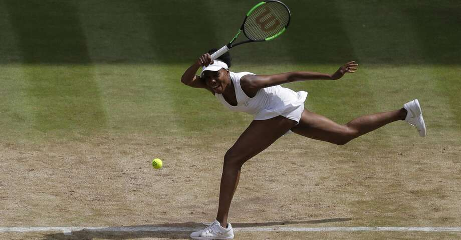 Venus Williams of the United States returns to Britain's Johanna Konta during their Women's Singles semifinal match on day nine at the Wimbledon Tennis Championships in London Thursday, July 13, 2017. (AP Photo/Alastair Grant) Photo: Alastair Grant/Associated Press