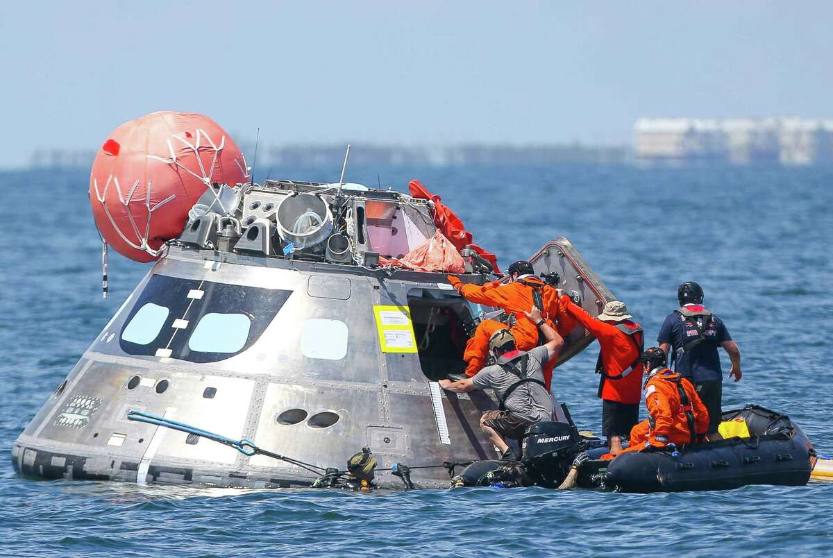 Support staff help four NASA astronauts board the Orion capsule they are using for a recovery test about four miles off of Galveston Island in the Gulf of Mexico, Thursday, July 13, 2017. The testing is the first time since the Apollo program that NASA has practiced such egress techniques from a capsule in open water. (Mark Mulligan / Houston Chronicle)