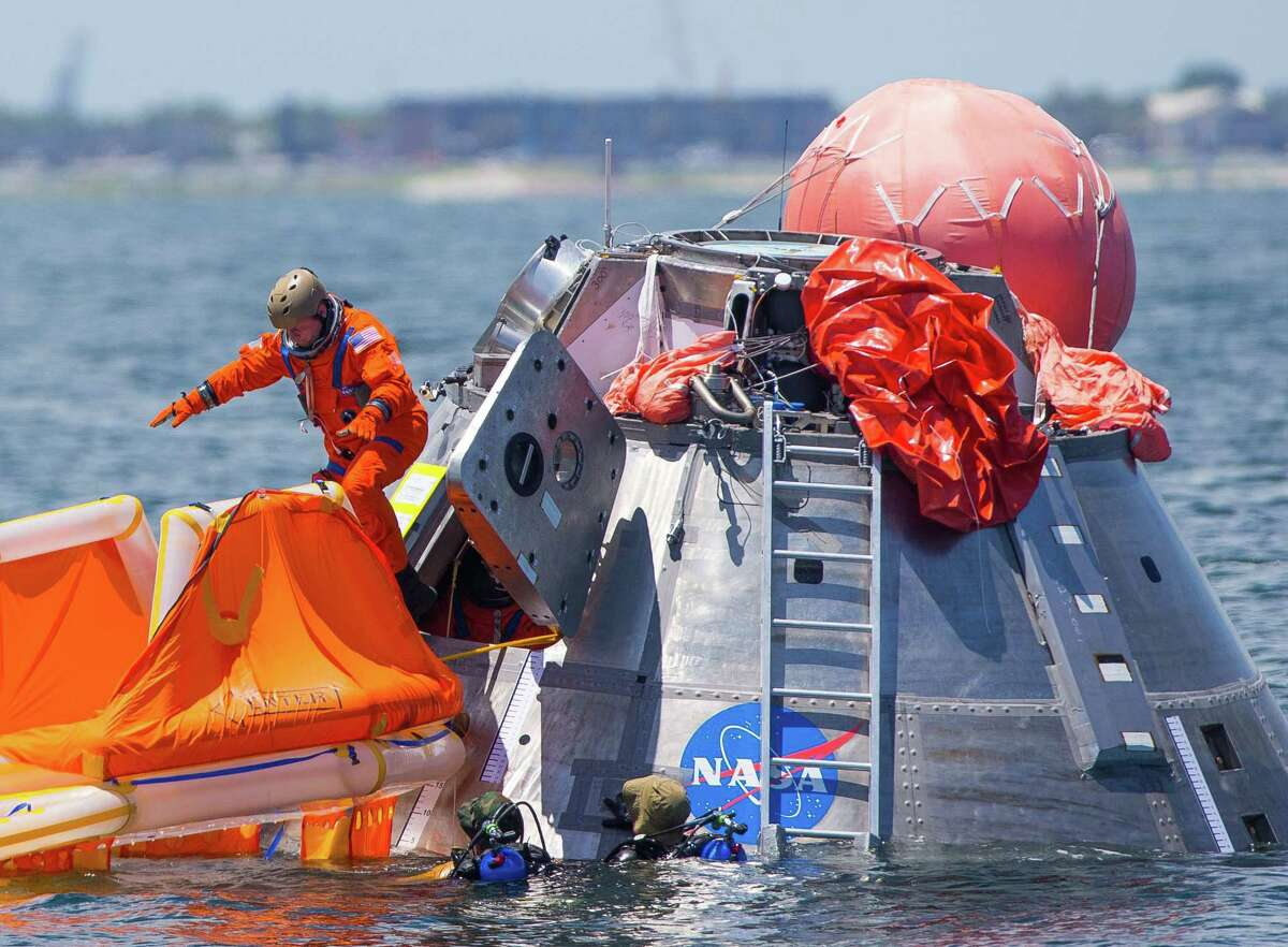 NASA astronaut Mike Fincke jumps into a life raft from an Orion capsule the astronauts are using for a recovery test about four miles off of Galveston Island in the Gulf of Mexico, Thursday, July 13, 2017. The testing is the first time since the Apollo program that NASA has practiced such egress techniques from a capsule in open water. (Mark Mulligan / Houston Chronicle)