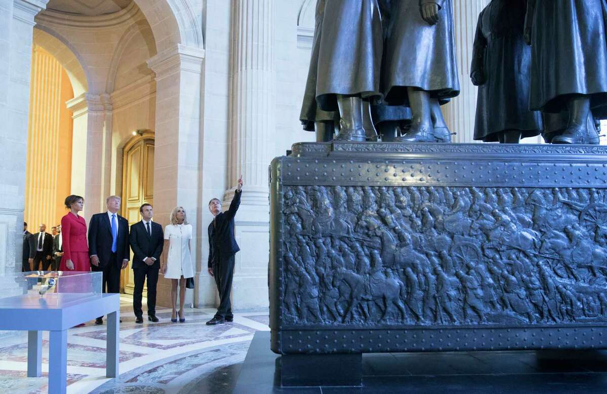 First lady Melania Trump, President Donald Trump, French President Emmanuel Macron his wife Brigitte Macron, tour Marechal Foch's Tomb at the Invalides monument in Paris on Thursday.